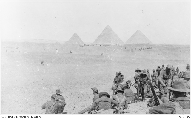 Troops of the 10th Battalion taking a rest break during training in the desert.  Australian War Memorial collection A02135