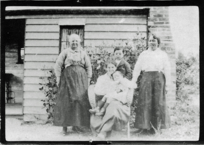 A welcoming home Elizabeth Ann Stewart (nee Ball) with her daughter Jane (seated), daughter-in-law Amelia Bruce Tan Loo Stewart and Amelia's children Clarence and Nellie Stewart