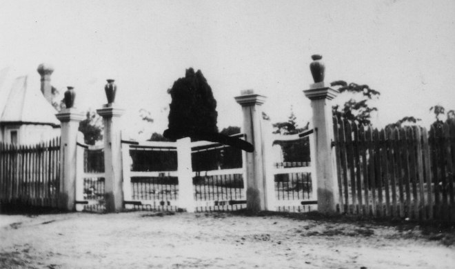 Amherst Cemetery gates, with the fence that Andy repaired in 1927. The Sexton's cottage on the left. Reproduced courtesy of the Talbot Arts & Historical Museum Inc.